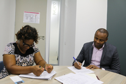 The Trade Hub's Osadi Kebasitile and Solidaridad Mozambique Country Programme Manager Francisco Nhanale signing the grant close-out documents